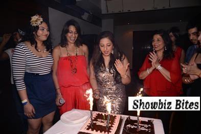 Cake cutting-left to right-Tanya Abrol, Hansa, Munisha Khatwani and her mother