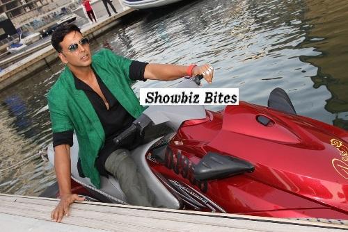 Akshay Kumar enters the press conference on a Jet Ski in Dubai. 01