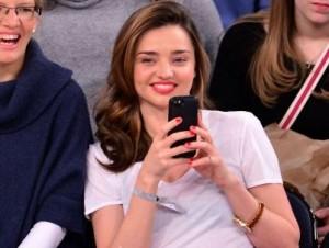 Miranda Kerr Looks Dashing in Ripped Denim Watching Basketball Match in NY